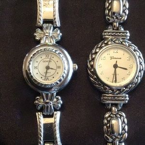 Two silver Geneva watches.
